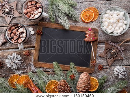 Christmas holidays background. Hot Chocolate, Blackboard and Christmas Decorations. Lots of copy space