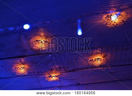 New Year background with snowflake lights on blue. New Year and Christmas concept