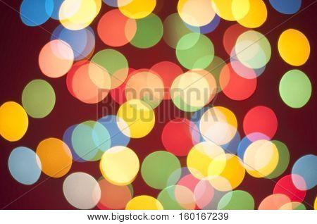 Bokeh lights background. Abstract multicolored light. Blur spot light. Defocus colorful light. Colorful blur light background. Defocused light. Bokeh light texture. Christmas blur light on red background. Light abstract. Circle multicolored blur light.