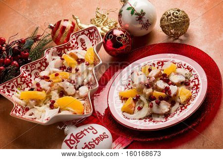 octopus salad with fennel orange and pomegranate over christmas table
