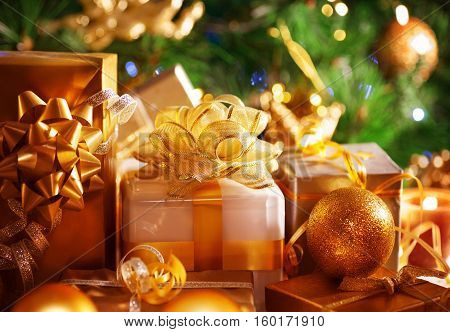 Image of luxury New Year gifts different present boxes under Christmas tree in holiday eve Christmastime celebration home decorated with festive shiny balls magic x-mas night