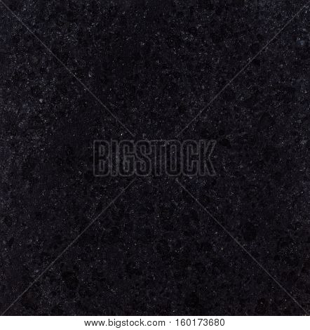 Natural black polished Chinese G684 granite texture.