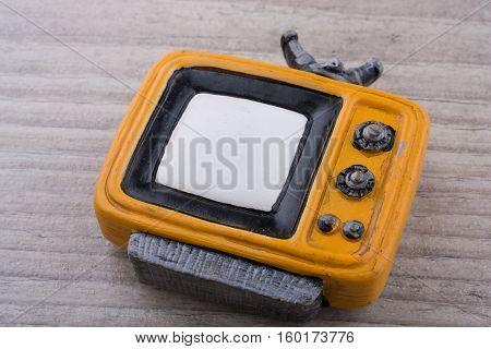 Retro Syled Tiny Television Model On Grey Background