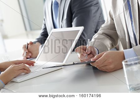 Close-up photo of human hands during business meeting