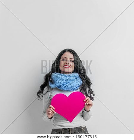 Valentines Day. Woman holding Valentines Day paper heart with copy space