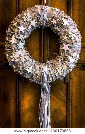 Christmas wreath on a rustic wooden door.