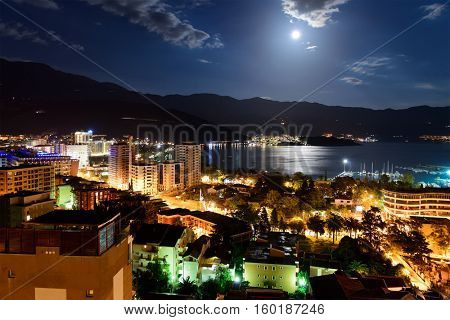 Budva city and bay at night, Montenegro, Europe. Street and moon light