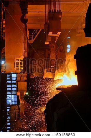 steel mills converter filling hot materials, close up