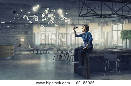 Guy making announcement . Mixed media