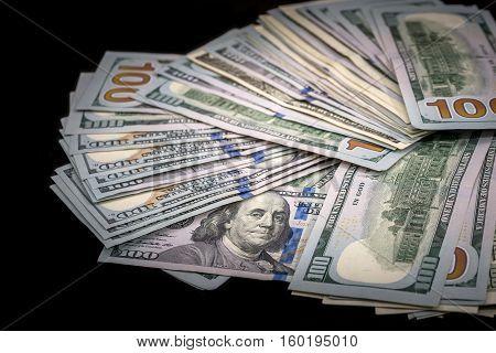 100 us dollar biils on  isolated black