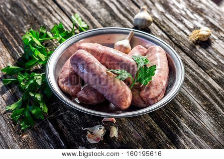 Raw Sausage With Spices On   Wooden Background