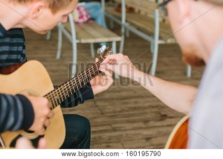 Learning to play the guitar. Music education and extra-curricular lessons.