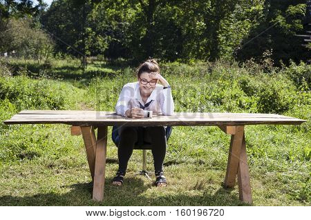 Business Woman Watching Video On Mobile