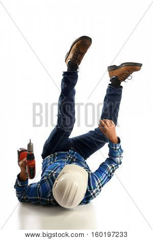 Worker holding cordless screwdriver falling on floor isolated over white background