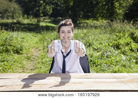 Business Woman Shows Two Thumbs Up