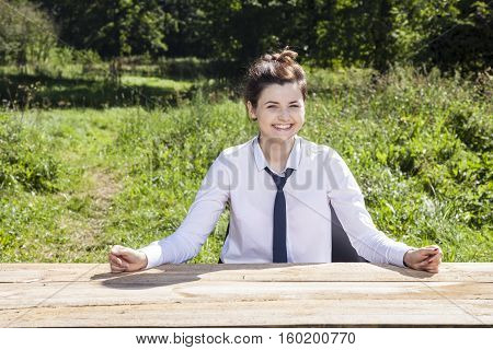 Smiling Business Woman Shows Her Desk