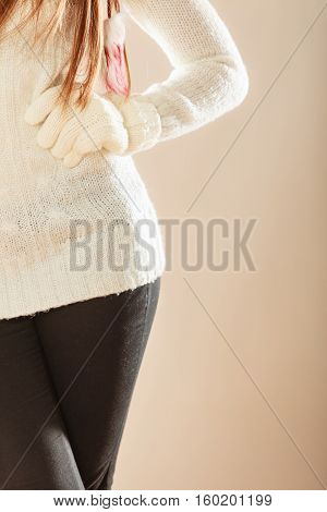 Young woman in xmas fashion. Girls hands in woolen white gloves. Christmas time concept.