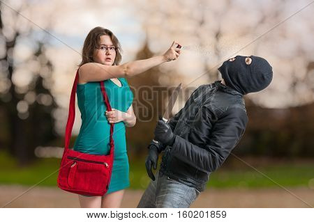 Young Woman Is Defending With Pepper Spray Against Armed Thief W