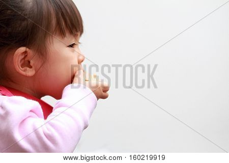 Japanese girl eating wafers (2 years old)
