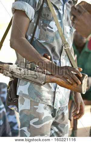 African soldier holding rifle in South Sudan