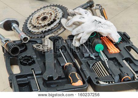 Bike repairing. Spare parts and tools box.