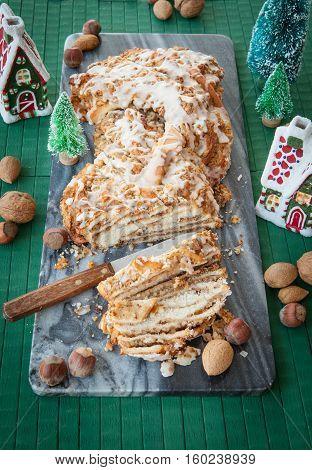 Homemade braided nutcake with quaint christmas decorations