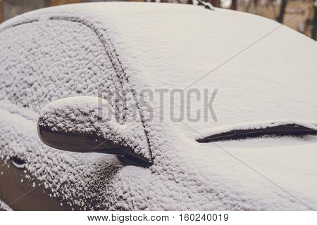 car covered by snow in the morning