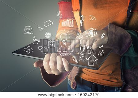 Female hand touching screen modern tablet with business icons and symbols.