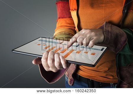 Hand touching screen modern tablet with financial graph. Business analysis concept.