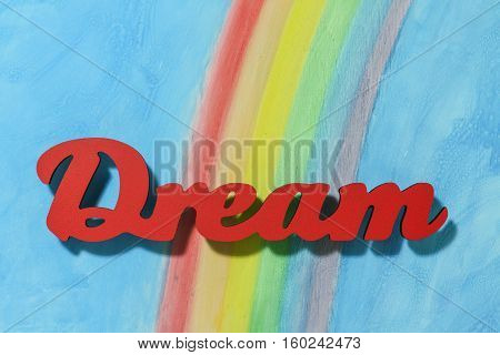 Red letters spelling the word dream to illustrate the concept of inspiration ambition and motivation.