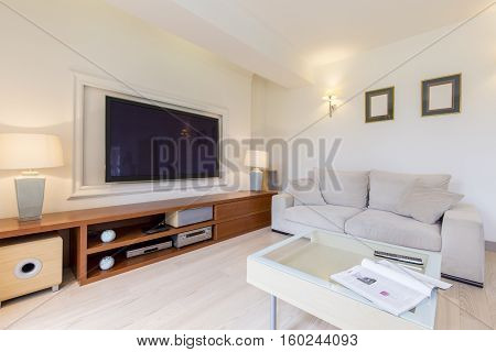 Room With Sofa And Tv Set