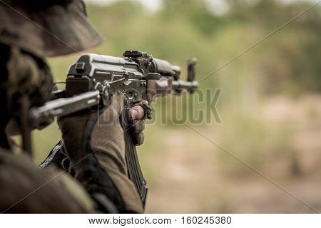 Marine Aiming From Machine Gun