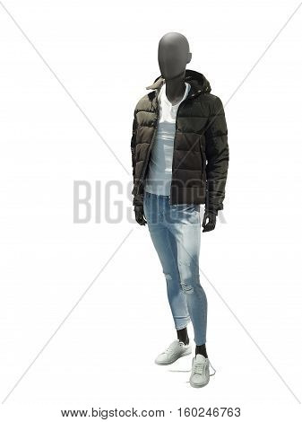Full-length male mannequin dressed in warm jacket and blue jeans isolated on white background. No brand names or copyright objects.