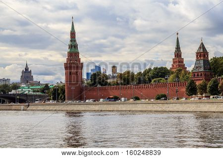 Moscow Kremlin towers but the background of the cloudy sky, a view from the waterfront
