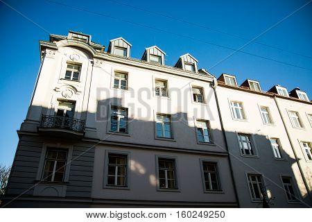 old houses in munich - schwabing, blue sky