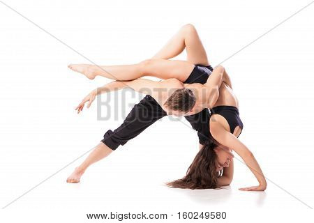 Acrobatic dancing pair doing hard pose. Isolated horizontal studio shot