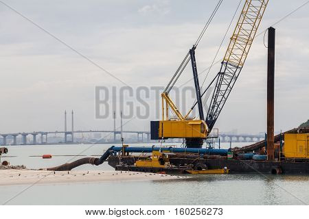 Sand replenishment ship on shore for land reclamation