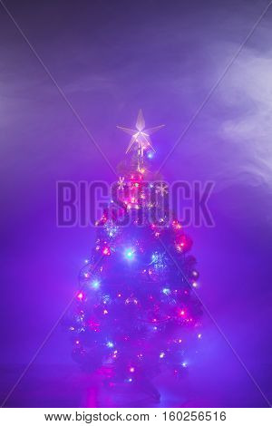 Christmas tree in dense smoke