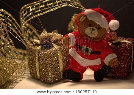 close up bear Santa Claus with gifts
