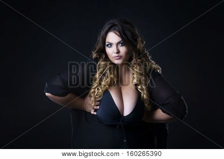 Young beautiful plus size model in underwear xxl woman on black background professional makeup and hairstyle