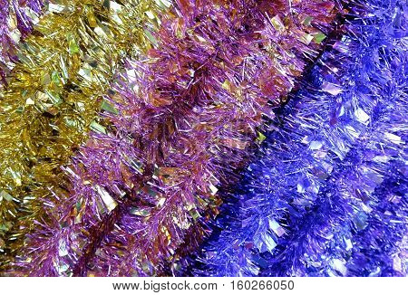 Background of the Christmas tinsel yellow purple and blue