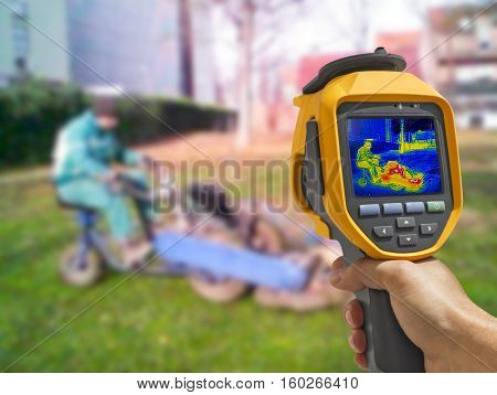 Recording with Thermal camera workers cutting grass in city park