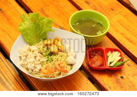 Crab noodles original with prawn shrimp and vegetable in white bowl