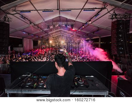 NEW YORK, NY - JUNE 18, 2016: Bassjackers perform at Governors Club on Governors Island, June 18, 2016 in New York City.  View from behind the DJ.