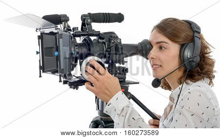 beautiful young woman with DSLR video camera and headphones