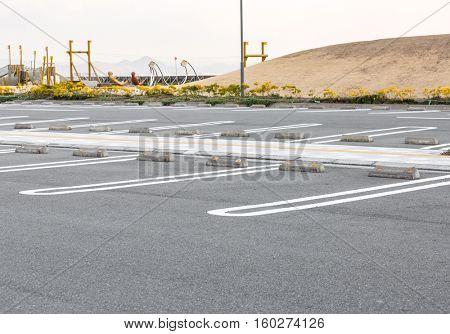Empty parking lot in outdoor parking area of garden