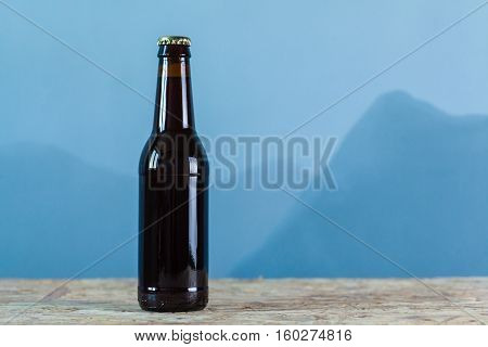 Beer Bottle Over Blue