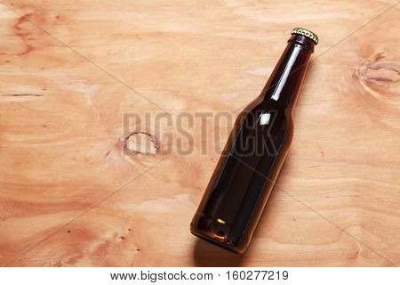 Beer Bottle On Wood