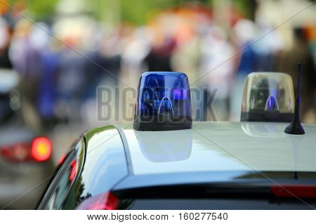 Police Car With Blue Sirens During The Event