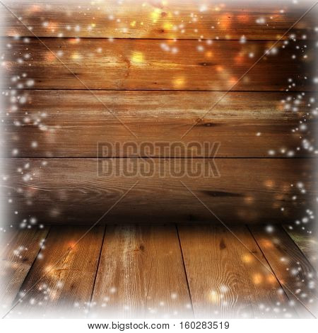 Christmas rustic background - vintage planked wood with lights and free text space.Old wooden boards and falling snow. Winter. New Year.